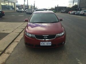 2010 Kia Cerato TD MY10 S Burgundy 5 Speed Manual Sedan Fyshwick South Canberra Preview