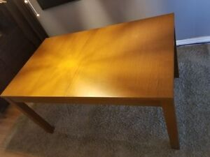 Ikea Bjursta dinning table + ( 4 chairs for free).