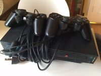 Playstation 2 plus 18 assorted games and 2 handsets