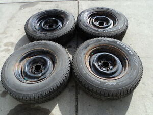 4 Toyo winter tires with steel rims 205/75/15