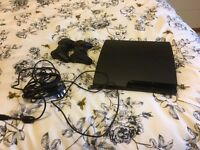 Used PS3, includes two controllers and three great games