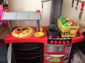 Play kitchen with utensils and play food