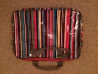 Stripy and padded laptop bag