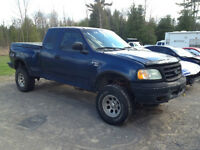 2002 Ford F-150 4' lift. also a 2000 F150 4x4 parts truck.