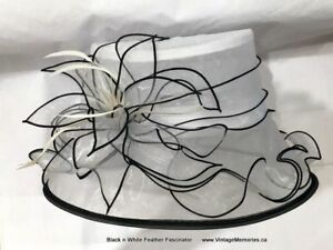 Brand new Beautiful feather fascinator hair clip band On Sale