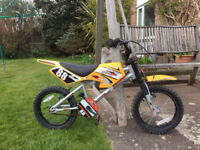 "Silver/yellow 'Motobike MXR450' bike in good condition. 10"" frame, 16"" wheels."