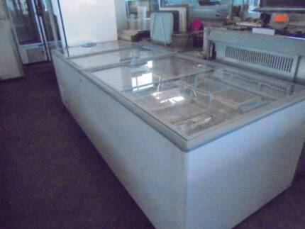 FREEZER - AS NEW COMMERCIAL DISPLAY FREEZER $1500