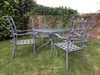 Quality aluminium garden furniture, 4 chairs, glass topped table.