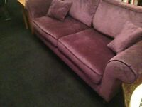 Rich purple plush velvet look, retro vintage style 3 seater sofa, settee with mahogany legs and