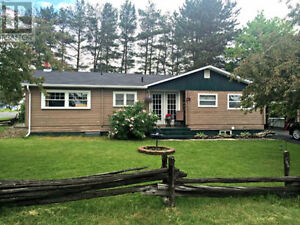 Log cabin style house for sale in Nackawic, New Brunswick