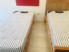 Hardly used/ great condition. Solid Oak SingleTrundle Guest Bed plus Deep Orthopaedic Mattresses.