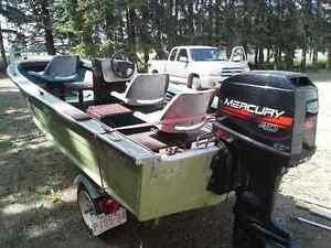 14.5 foot aluminum Starcraft w/ 40HP Merc & Shorelander trailer