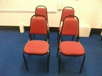 4 stackable chairs . Red colour Heavy Duty .£40 for set