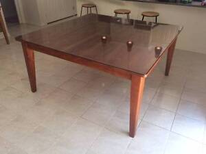 Square, wooden dining table with glass top Lynbrook Casey Area Preview