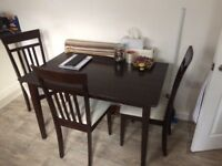 Dining table with 4 chairs. 40.