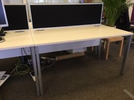 8 white office desks. Excellent condition with integral cable trays. Collection only