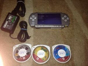 Psp 3001 system with charger and 3 games 1gb sitck