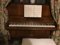 Upright piano in good condition for sale