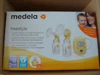Medela Freestyle Double Electric Breastpump with Calma. RRP £329.99. From a pet/smoke free home