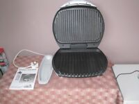 George Foreman Grill. Very little used. Complete with tools and instruction book