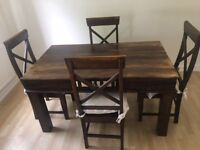 Solid Wood Dining Table with Four Matching Chairs and Cushions