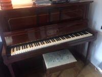 Lovely piano and piano stool