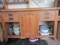 large kitchen free standing oak unit with black granite worktop. 2 draws and cupboard.