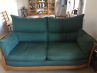 ERCOL RENAISSANCE THREE SEATER SOFA AND HIS AND HERS CHAIRS.