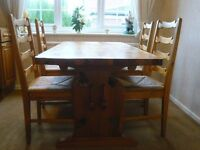 Solid pine dining table and four matching chairs (good condition!)