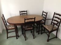 extendable dining room table & 5 chairs one a carver,