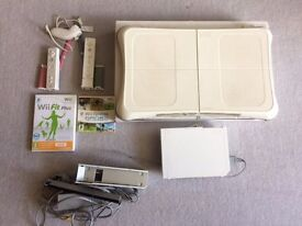 Nintendo Wii + Wii Fit Plus (Wii Fit Plus Board + Game!) + Wii Fit - 2 Controllers - Pink and Blue