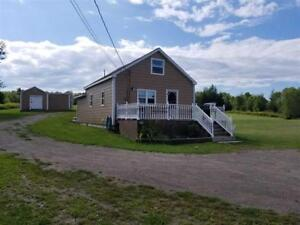 Cozy home situated on 3 acres with LOTS of potential