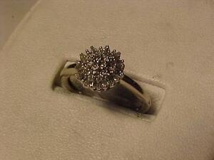 #3182-10K WHITE GOLD DIAMOND CLUSTER Size 7-SELL $165.00 WILL SHIP IN CANADA ONLY-$7.50-LAYAWAY AVAILABLE