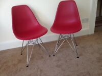 Four new Eames-style dining chairs.
