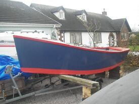 USA design Transom stern Dory on galvanised trailer with outboard.