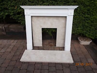 Marble fireplace hearth and wood surround