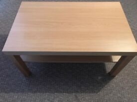 Lovely solid coffee table with shelf for storage