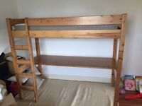 Childs pine bed with desk underneath, complete with ladder