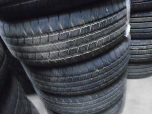 FOUR USED ALL SEASON TIRES 215-60-16 { GOODYEAR } R.H AUTO