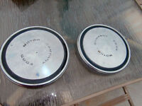 2 old ford moon center caps with markings saying ford moter com
