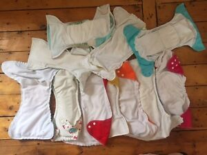 Assortment of 10 cloth diapers