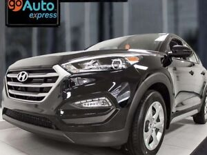 2017 Hyundai Tucson SE AWD with a back up cam and heated seats.