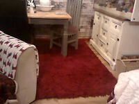 thick red large shaggy rug