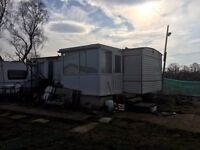 Static caravan used during new build project