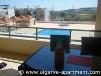 Algarve holiday apartment for rent overlooking pool in Meia Praia, close to beach and Lagos Old Town