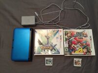 Nintendo 3DS XL with Pokemon X and Super Smash Bros