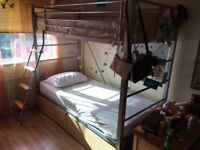 A metal bunk bed for sale.