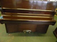 piano upright overstrung over damped mahogany cased by Bentley