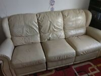 3 seater double reclining settee in cream leather.