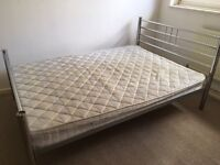 Two used double beds with mattresses, and two cabinets